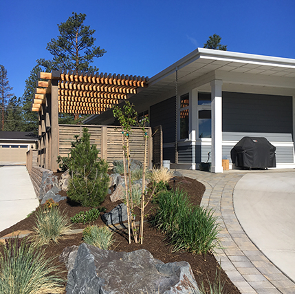Sisters Small Space-paver driveway border to widen radius, pergola to give shade to outdoor living area, curb appeal planting with Mugho Pine, Bristlecone Pine.